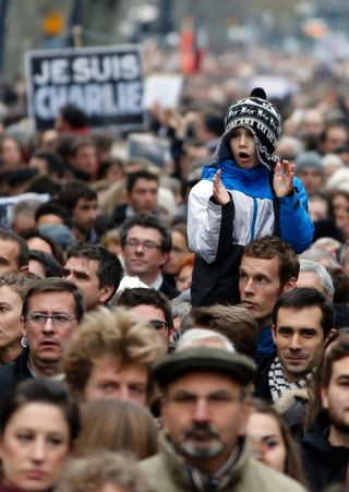 Guardian.Jan 10.A child joins in during a march in Toulouse.Guilaume Horajuelo:EPA