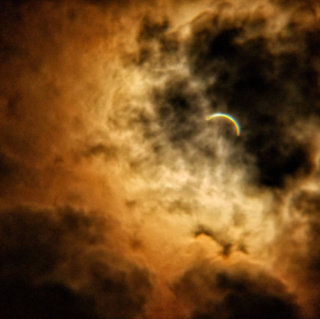 Eclipse at Homestead. The clouds part and...!