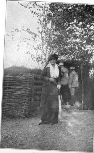 Edith Wharton in front of a French palisade  1915