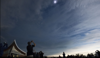 Viewing the eclipse at the Homestead.the sun peaks through the clouds