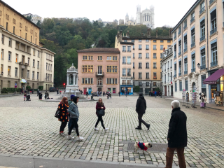 Lyon.courtyard with church on hill.15NOV2019