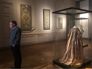 Lyon.Musée des Tissus. interior showing 18c robe française.17NOV2019