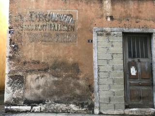 Vienne.Old doorway and street sign.Nov2019