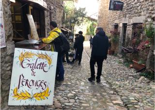 Pérouges.Galettes for sale in old medieval street.Nov 2019