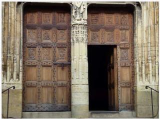 St-Côme-d'Olt.oak church doors from 1522.
