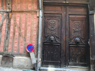 Troyes.Old door.Older half-timbered wall.modern traffic sign.Oct2018