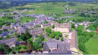 Saint-Albans-sur-Limagnole.aerial view of chateau.